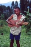 boy;male;africa;african;africans;east-africa;central-africa;instrument;ukelele;ukeleles;guitars;guitar;music;musical;play;perform;wood;wooden;home_made;young;rag;rags;child;children;kid;kids;poor;poverty;child;children;africa;african;africans;black;ethnic;person;portrait;portraits;tradition;traditional;culture;cultural;tribe;tribal;east-africa;central-africa;democratic-republic-of-congo;congo;zaire;jungle;rainforest;east-africa;central-africa