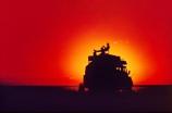 4wd;4x4;Africa;African;Botswana;camp;camping;color;colors;colour;colours;desert;deserts;four-wheel-drive;Kalahari;Kalahari-Desert;orange;overland-truck;overlander;overlanders;people;person;relax;relaxing;silhouette;silhouettes;Southern-Africa;sundown;sundowner;sunset;sunsets;trucks;vehicle;wilderness