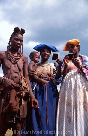 woman;women;himba;herero;cowrie;namibia;southern-africa;africa;african;tradition;traditional;traditions;culture;cultures;cultural;indigenous;native;jewelry;jewellery;adorn;adornment;adornments;costume;costumes;braiding;necklace;necklaces;ochre;shell;shells;baby;babies;infant;infants