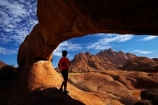 Africa;archway;archways;bald-granite-peak;bald-granite-peaks;bornhardts;boy;boys;child;children;Erongo-Region;families;family;family-holiday;family-holidays;geological;geology;Groot-Spitzkop;holiday;holidays;inselberg;inselbergs;monadnock;monadnocks;Namib-Desert;Namibia;Natural-Arch;Natural-Arches;natural-bridge;natural-bridges;natural-geological-formation;natural-geological-formations;Natural-Rock-Arch;natural-rock-arches;natural-rock-archs;natural-rock-bridge;natural-rock-bridges;people;person;Pondok;Pondok-Mountain;Pondok-Mountains;Pondoks;rock;rock-arch;rock-arches;rock-formation;rock-formations;rock-outcrop;rock-outcrops;rock-tor;rock-torr;rock-torrs;rock-tors;rocks;Southern-Africa;Spitzkop;Spitzkoppe;stone;tourism;tourist;tourists;unusual-natural-feature;unusual-natural-features;unusual-natural-formation;unusual-natural-formations;wilderness;wilderness-area;wilderness-areas