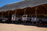 4wd;4wds;4wds;4x4;4x4s;4x4s;Africa;Damaraland;four-by-four;four-by-fours;four-wheel-drive;four-wheel-drives;heat;hot;Kunene-District;Kunene-Region;Namibia;park;parking;parks;Petrified-Forest;shade;shady;Southern-Africa;sports-utility-vehicle;sports-utility-vehicles;suv;suvs;under-cover-parking;vehicle;vehicles