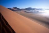 Sossusvlei;Namib_Naukluft-National-Park;national-park;Namibia;Southern-Africa;Africa;African;arid;aridity;barren;barreness;desert;deserts;deserted;empty;wilderness;solitude;sand-dune;dunes;sand_dune;sand_dunes;natural;nature;hot;remote;landscape;landscapes;desolate;desolation;ecosystem;ecosystems;loneliness;orange;red;namib;curve;curves;line;lines;misty;ripple;ripples;sand;sand-dune;sand-dunes;dune;dunes;cloud;mist;fog;low-cloud;slope;slopes;angle;sparse