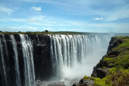 Africa;cascade;cascades;chasm;chasms;fall;falls;international-border;international-borders;Mosi_oa_Tunya;natural;natural-wonders-of-the-world;nature;ravine;ravines;river;rivers;scene;scenic;seven-natural-wonders;seven-natural-wonders-of-the-world;seven-wonders-of-the-natural-world;seven-wonders-of-the-world;Southern-Africa;spray;the-Smoke-that-Thunders;UN-world-heritage-area;UN-world-heritage-site;UNESCO-World-Heritage-area;UNESCO-World-Heritage-Site;united-nations-world-heritage-area;united-nations-world-heritage-site;V.F.;VF;Vic-Falls;Vic.-Falls;Victoria-Falls;Victoria-Falls-National-Park;water;water-fall;water-falls;waterfall;waterfalls;wet;world-heritage;world-heritage-area;world-heritage-areas;World-Heritage-Park;World-Heritage-site;World-Heritage-Sites;Zambesi;Zambesi-River;Zambeze;Zambeze-River;Zambezi;Zambezi-River;Zambia;Zimbabwe
