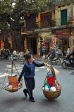 Asia;Asian;carrying-pole;carrying-stick;hanging-basket;hanging-baskets;Hanoi;hawker;hawkers;milkmaids-yoke;Old-Quarter;South-East-Asia;Southeast-Asia;street;street-scene;street-scenes;street-vendor;street-vendors;streets;vendor;vendors;Vietnam;Vietnamese;yoke;yokes