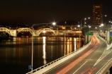 australasia;Australia;australian;bridges;Brisbane;Brisbane-River;car;cars;cities;city;cityscape;cityscapes;expressway;expressways;freeway;freeways;illuminate;illuminated;light;lights;motorway;motorways;night;night-time;Queensland;reflection;reflections;rivers;Riverside-Expressway;sheen;shimmer;tail-lights;traffic;tranport;transportation;water;William-Jolly-Bridge