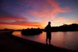 Australasian;Australia;Australian;breakwater;breakwaters;Darwin;Darwin-Harbor;Darwin-Harbour;Darwin-Waterfront;Darwin-Waterfront-Precinct;dusk;evening;groyne;groynes;mole;moles;N.T.;nightfall;Northern-Territory;NT;orange;people;person;Port-Darwin;recreation-lagoon;sea-wall;sea-walls;seawall;seawalls;silhouette;sky;Stokes-Hill-Wharf;sunset;sunsets;Top-End;twilight