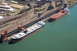 aerial;aerial-photo;aerial-photograph;aerial-photographs;aerial-photography;aerial-photos;aerial-view;aerial-views;aerials;Australasia;Australia;Australian;bulk-carriers;cargo;Carrington-Coal-Terminal;climate-change;coal;coal-depot;coal-industry;coal-ship;coal-ships;commodities;commodity;energy;export;exporters;exporting;exports;fossil-fuel;fossil-fuels;freight;freighter;freighters;freights;fuel;global-warming;Hunter-River;industrial;industry;N.S.W.;natural;New-South-Wales;Newcastle;Newcastle-Harbor;Newcastle-Harbour;non-renewable;non_renewable;non_sustainable;nonrenewable;nonsustainable;NSW;Ocean-Planet;port;Port-of-Newcastle;Port-Waratah-Coal-Services-Limited;ports;power;PWCS;resource;ship;shipping;ships;trade;wharf;wharves