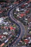 Highway;highways;Olympic;Park;Sydney;Australia;aerial;aerials;road;roads;roading;car;cars;transport;traffic;transportation;s-bend;s;bend;residential;residences;housing;houses;house