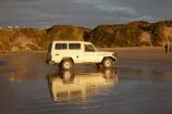 4wd;4wds;4wds;4x4;4x4s;4x4s;Australasian;Australia;Australian;beach;beaches;calm;coast;coastal;coastline;four-by-four;four-by-fours;four-wheel-drive;four-wheel-drives;Island-of-Tasmania;Ocean-Beach;reflection;reflections;sand;sandy;smooth;sports-utility-vehicle;sports-utility-vehicles;State-of-Tasmania;Strahan;suv;suvs;Tas;Tasmania;The-West;Toyota-Landscruiser;vehicle;vehicles;West-Tasmania;Western-Tasmania