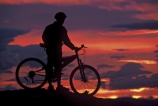 bike;cycle;cyclist;biker;bikes;cycles;bicycle;bicycles;high-country;sports;sunset;color;colors;colour;colours;orange;dusk;twilight;silhouette;silhouettes;person.-people;sky;red