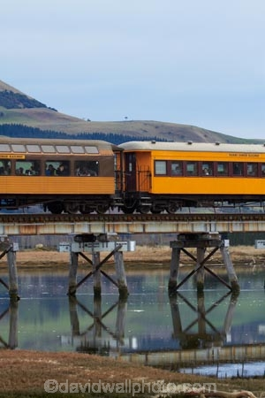 bridge;bridges;calm;Dunedin;excursion-train;N.Z.;New-Zealand;Otago;passenger-train;passenger-trains;placid;quiet;rail-bridge;rail-bridges;rail-line;rail-lines;rail-track;rail-tracks;railroad;railroads;railway;railway-line;railway-lines;railway-track;railway-tracks;railways;reflected;reflection;reflections;S.I.;Seasider-Train;serene;SI;smooth;South-Is;South-Island;Sth-Is;still;Taieri-Gorge-Seasider-Train;Taieri-Gorge-Seasider-Train;tourist-attraction;tourist-attractions;tourist-train;tourist-trains;track;tracks;train;train-bridge;train-bridges;train-track;train-tracks;trains;tranquil;transport;transportation;water;wooden-bridge;wooden-bridges;wooden-rail-bridge;wooden-rail-bridges