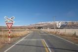 cross;crosses;give-way-sign;level-crossing;level-crossings;Middlemarch;N.Z.;New-Zealand;NZ;Otago;rail;rail-crossing;rail-crossings;railroad;railroads;railway;railway-crossing;railway-crossings;railways;range;ranges;Rock-amp;-Pillar-Range;S.I.;SI;sign;signage;signs;snow-capped;snow_capped;snowcapped;snowy;South-Is.;South-Island;Strath-Taieri;Sutton;tracks;train;trains;transport;transportation;twilight;warning;warning-sign;warning-signs;x