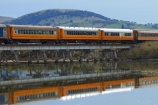bridge;bridges;calm;Dunedin;excursion-train;N.Z.;New-Zealand;Otago;passenger-train;passenger-trains;placid;quiet;rail-bridge;rail-bridges;rail-line;rail-lines;rail-track;rail-tracks;railroad;railroads;railway;railway-line;railway-lines;railway-track;railway-tracks;railways;reflected;reflection;reflections;S.I.;Seasider-Train;serene;SI;smooth;South-Is;South-Island;Sth-Is;still;Taieri-Gorge-Seasider-Train;Taieri-Gorge-Seasider-Train;tourist-attraction;tourist-attractions;tourist-train;tourist-trains;track;tracks;train;train-bridge;train-bridges;train-track;train-tracks;trains;tranquil;transport;transportation;water;wooden-bridge;wooden-bridges;wooden-rail-bridge;wooden-rail-bridges