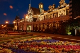 1906;architectural;architecture;bloom;blooming;blooms;building;buildings;dark;Dunedin;Dunedin-Railway-Station;dusk;evening;Flemish-Renaissance-style;flood-light;flood-lights;flood-lit;floodlit;floral;flower;flower-bed;flower-beds;flower-garden;flower-gardens;flowers;garden;gardens;George-A-Troup;Gingerbread-George;heritage;historic;historic-building;historic-buildings;Historic-Railway-Station;historical;historical-building;historical-buildings;history;light;lighting;lights;N.Z.;New-Zealand;night;night-time;night_time;nightfall;nighttime;NZ;old;Otago;public-flower-garden;public-garden;public-gardens;rail;rail-station;rail-stations;railroad;railroads;rails;railway;railway-station;railway-stations;railways;S.I.;SI;South-Is;South-Is.;South-Island;Sth-Is;tail-lights;tradition;traditional;train-station;train-stations;transport;transportation;twilight