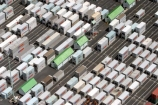 container;containers;yard;asphalt;row;rows;stack;stacked;hut;huts;green;green-roof;green-rooves;green-roofs;neat;orderly