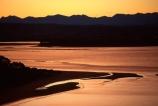 coast;coastal;coastline;shore;shoreline;shore-line;coast-line;beach;beaches;tahunanui;colour;colours;color;colors;orange;dusk;twilight;sea;ocean;inlet;inlets;lagoon;lagoons;estuary;estuaries;people;person;sand;walks;walking;Walkers;Sunset;sunsets;Nelson;south-island;new-zealand;waimea-inlet;tasman-bay