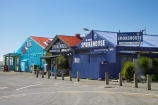 blue;building;buildings;colorful;colourful;corrugated-iron;corrugated-steel;Mapua;Mapua-Wharf;N.Z.;Nelson-Region;New-Zealand;NZ;S.I.;SI;South-Is.;South-Island;Tasman-Bay;The-Mutton-Bird-Cafe;The-Muttonbird-Cafe;The-Original-Smokehouse;The-Smoke-House;The-Smoke_House;The-Smokehouse
