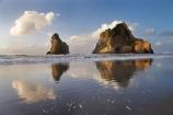 Archway-Is;Archway-Is.;Archway-Island;Archway-Islands;beach;beaches;calm;coast;coastal;coastline;foreshore;geological;geology;N.Z.;Nelson-Region;New-Zealand;North-West-Nelson-Region;NZ;placid;quiet;reflection;reflections;rock;rock-formation;rock-formations;rock-outcrop;rock-outcrops;rock-tor;rock-torr;rock-torrs;rock-tors;rocks;S.I.;sand;sandy;serene;shore;shoreline;SI;smooth;South-Is.;South-Island;still;stone;Tasman-Sea;tranquil;water;Wharariki-Beach