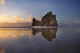 Archway-Is;Archway-Is.;Archway-Island;Archway-Islands;beach;beaches;calm;coast;coastal;coastline;dusk;evening;foreshore;geological;geology;N.Z.;Nelson-Region;New-Zealand;nightfall;North-West-Nelson-Region;NZ;placid;quiet;reflection;reflections;rock;rock-archway;rock-archways;rock-formation;rock-formations;rock-outcrop;rock-outcrops;rock-tor;rock-torr;rock-torrs;rock-tors;rocks;S.I.;sand;sandy;serene;shore;shoreline;SI;sky;smooth;South-Is.;South-Island;still;stone;sunset;sunsets;Tasman-Sea;tranquil;twilight;water;Wharariki-Beach