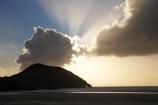 beach;beaches;coast;coastal;coastline;dusk;evening;finger-of-god;N.Z.;Nelson-Region;New-Zealand;nightfall;North-West-Nelson-Region;NZ;Pilch-Point;ray-of-light;S.I.;sand;sandy;shore;shoreline;SI;sky;South-Is.;South-Island;sunset;sunsets;Tasman-Sea;twilight;Wharariki-Beach