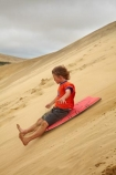 action;adrenaline;adventure;adventure-tourism;boogie-boarding;boy;boys;child;children;dune;dune-board;dune-boarding;dune-surfing;dunes;excite;excitement;exciting;Far-North;fast;fun;kid;kids;little-boy;little-boys;N.I.;N.Z.;New-Zealand;NI;North-Is;North-Is.;North-Island;Northland;NZ;people;person;sand;sand-boarding;sand-dune;sand-dunes;sand-hill;sand-hills;sand-surfing;sand_dune;sand_dunes;sand_hill;sand_hills;sandboarding;sanddune;sanddunes;sandhill;sandhills;sandsurfing;sandy;scary;speed;Te-Paki-Creek;Te-Paki-Dunes;Te-Paki-Recreational-Reserve;Te-Paki-Reserve;Te-Paki-Sand-Dunes;Te-Paki-Sand-Hills;Te-Paki-Stream;tourism;tourist;tourists