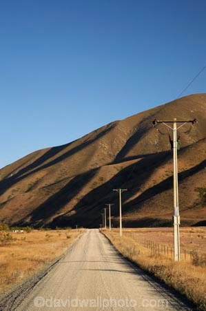 agriculture;Ahuriri-Valley;Birchwood-Road;country;countryside;drought;dry;dusty;farm;farming;farmland;farms;field;fields;gravel-road;gravel-roads;line;lines;meadow;meadows;metal-road;metal-roads;metalled-road;metalled-roads;New-Zealand;North-Otago;Otago;paddock;paddocks;pasture;pastures;pole;poles;post;posts;power-line;power-lines;power-pole;power-poles;road;roads;rural;South-Island;straight;straights;summer;telegraph-line;telegraph-lines;telegraph-pole;telegraph-poles;Waitaki-District;wire;wires