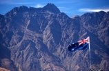 Queenstown;Central-Otago;The-Remarkables;remarkables;mountain;mountains;rocky;point;points;peak;peaks;peaked;jagged;flag;flags;new-zealand;icon;south-island;nation;nationality;identity;flag-pole;wind;windy