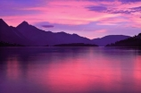 alpine;mountain;mountains;Queenstown;south-island;new-zealand;sky;effect;lighting;unusual;last-light;sunlight;ray;twilight;lake;lakes;lake-wakatipu;wakatipu;colour;color;warm;pink;pinkish;sunset;reflection;reflections;calm;peaceful;peacefulness;calmness