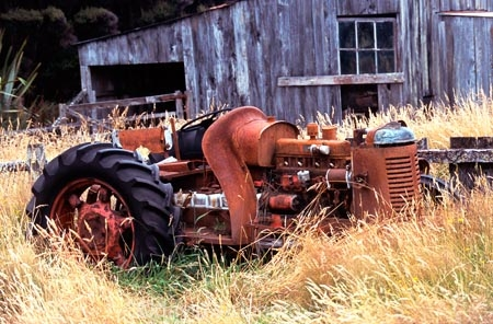 tractor;farm-machinery;relic;tractors;neglect;neglected;abandoned;forgotten;forsaken;overgrown;shed;ruin;rust;rusted