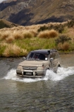4wd;4wds;4wds;4x4;4x4s;4x4s;back-country;backcountry;ford;fording;fords;four-by-four;four-by-fours;four-wheel-drive;four-wheel-drives;high-altitude;high-country;highcountry;highlands;Livingstone-Mountains;Mararoa-River;Mavora-Lakes;N.Z.;New-Zealand;NZ;remote;remoteness;river;river-crossing;river-crossings;rivers;S.I.;SI;South-Is;South-Island;Southland;splash;splashing;sports-utility-vehicle;sports-utility-vehicles;Sth-Is;suv;suvs;Toyota-Prado;Toyota-Prados;Toyotas;tussock;tussocks;upland;uplands;vehicle;vehicles