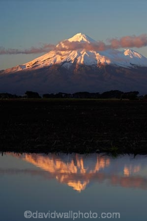 alpenglo;alpenglow;alpine;alpinglo;alpinglow;calm;color;colors;colour;colours;Egmont-N.P.;Egmont-National-Park;Egmont-NP;Mount-Egmont;Mount-Taranaki;Mount-Taranaki-Egmont;Mountain;mountainous;mountains;mt;Mt-Egmont;Mt-Taranaki;Mt-Taranaki-Egmont;mt.;Mt.-Egmont;Mt.-Taranaki;Mt.-Taranaki-Egmont;N.I.;N.Z.;New-Zealand;NI;North-Is;North-Is.;North-Island;NZ;Opunake;orange;placid;quiet;reflection;reflections;season;seasonal;seasons;serene;smooth;snow;still;Taranaki;tranquil;volcanic;volcano;volcanoes;water;winter