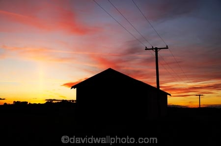 cloud;clouds;dusk;evening;Farm-Building;Farm-Buildings;Farm-Shed;Farm-Sheds;glow;line;lines;N.I.;N.Z.;New-Zealand;NI;nightfall;North-Island;NZ;Ohakune;orange;pole;poles;post;posts;power-line;power-lines;power-pole;power-poles;Ruapehu-District;Sheep-Shed;Sheep-Sheds;silhouette;silhouettes;sky;sunset;sunsets;telegraph-line;telegraph-lines;telegraph-pole;telegraph-poles;twilight;wire;wires;Wool-Shed;Wool-Sheds