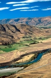 rivers;landscape;agriculture;rural;farming;farms;farm-blocks;block;land;landscape;hill;range;mountain;mountain-range;cultivated;Clutha;winding;curve;curving;river-course;dry;central-otago;arid;irrigation;field;fields;paddock;paddocks;meadow;meadows