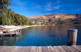 jetty;boat-dock;wood;wooden-post;willow-tree;willow-trees;holiday;vacation;destination;holiday-destination;vacation-destination;boat;boats;lake;lake-wanaka;tree;trees;willow;warm;droopy;droopy-tree;droopy-trees;jet-boat;jet-boats;ripple;ripples;rippling;duck;ducks;relax;relaxing