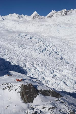 above;aerial;aerial-photo;aerial-photograph;aerial-photographs;aerial-photography;aerial-photos;aerial-view;aerial-views;aerials;Almer-Hut;alp;alpine;alps;back-country-hut;backcountry;backcountry-hut;backcountry-huts;climbers-hut;climbers-huts;cold;danger;DOC-hut;DOC-huts;Frans-Josef-Glacier-neve;Frans-Josef-neve;Franz-Josef-Glacier;glacial;glacier;glaciers;high-altitude;high-country-hut;highcountry;highcountry-hut;highcountry-huts;hikers-hut;hikers-huts;huits;hut;ice;icy;main-divide;mount;mountain;mountain-hut;mountain-huts;mountaineers-hut;mountaineers-huts;mountainous;mountains;mountainside;mt;mt.;N.Z.;neve;New-Zealand;NZ;outdoors;range;ranges;S.I.;SI;snow;snowy;South-Is.;South-Island;South-West-New-Zealand-World-Heritage-Area;southern-alps;Te-Poutini-National-Park;Te-Wahipounamu;trampers-hut;trampers-huts;West-Coast;Westland;westland-national-park;White;winter;World-Heritage-Area