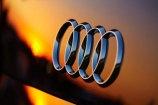 Audi;Audi-Badge;Audi-logo;Audi-Rings;automobile;automobiles;car;car-badge;cars;Chile;dusk;evening;four-rings;new;nightfall;orange;polished;reflect;reflection;reflections;shiny;sky;South-America;Sth-America;sunset;sunsets;tranportation;transport;twilight;vehicle;vehicles