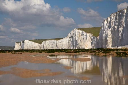 beach;beaches;Birling-Gap;Birling-Gap-Beach;bluff;bluffs;Britain;British-Isles;calm;chalk-cliff;chalk-cliffs;chalk-downland;chalk-downlands;chalk-downs;chalk-formation;chalk-formations;chalk-headland;chalk-headlands;chalk-layer;chalk-layers;cliff;cliffs;coast;coastal;coastline;coastlines;coasts;Cretaceous-chalk-layer;down;downland;downlands;downs;East-Sussex;England;English;English-Chanel;eroded;erosion;Europe;foreshore;formation;formations;G.B.;GB;geological;geological-formation;geological-formations;geology;Great-Britain;image;images;layer;layering;layers;limestone;low-tide;low-tides;natural;natural-landscape;natural-landscapes;ocean;oceans;people;person;photo;photos;placid;quiet;reflection;reflections;rock-formation;rock-formations;S.E.-England;SE-England;sea;seas;sedimentary-layer;sedimentary-layers;serene;Seven-Sisters;Seven-Sisters-Cliffs;Seven-Sisters-Country-Park;shore;shoreline;shorelines;shores;smooth;South-Downs;South-Downs-N.P.;South-Downs-National-Park;South-Downs-NP;South-East-England;Southern-England;steep;still;stone;strata;stratum;Sussex;The-Seven-Sisters;tidal;tide;tides;tranquil;U.K.;UK;United-Kingdom;unusual-natural-feature;unusual-natural-features;unusual-natural-formation;unusual-natural-formations;water;white-chalk-cliff;white-chalk-cliffs;White-Cliff;white-cliffs