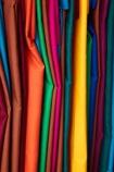bright;brightly-coloured-material;cloth;clothing;colorful;colourful;commerce;commercial;Fij;Fiji-Islands;green;market;market-place;market_place;marketplace;markets;material;orange;Pacific;pink;product;products;retail;retailer;retailers;shop;shopping;shops;South-Pacific;stall;stalls;steet-scene;street-scenes;Suva;Suva-Flea-Market;Viti-Levu;Viti-Levu-Island;yellow