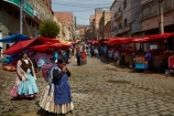 Aymara;Bolivia;Bolivian;Bolivians;capital;Capital-of-Bolivia;Cholita;cholita-pacenas;Cholitas;Chuqi-Yapu;cities;city;cobble-stone-streets;cobble_stoned;cobblestone;cobblestoned;cobblestones;colorful;colour;colourful;commerce;commercial;crowd;crowded;farmer-market;farmer-markets;farmers-market;farmers-markets;farmers-market;farmers-markets;female;food;food-market;food-markets;food-stall;food-stalls;fruit-market;fruit-markets;indigenous;La-Paz;Latin-America;market;market-day;market-days;market-place;market_place;marketplace;markets;Mercardo-Rodriguez;Nuestra-Señora-de-La-Paz;pedestrians;people;person;produce;produce-market;produce-markets;product;products;retail;retailer;retailers;Rodriguez-Market;shop;shopper;shoppers;shopping;shops;South-America;stall;stalls;steet-scene;Sth-America;street-scenes;The-Americas;woman;women