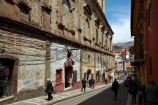 alley;alleys;alleyway;alleyways;Bolivia;Bolivian;building;buildings;capital;Capital-of-Bolivia;Cathedral-Basilica-of-Our-Lady-of-Peace;Chuqi-Yapu;cities;city;heritage;historic;historic-building;historic-buildings;historical;historical-building;historical-buildings;history;Hostel-Torino;Hotel-Torino;La-Paz;La-Paz-Basilica;La-Paz-Cathedral;Latin-America;Narrow-street;narrow-streets;Nuestra-Señora-de-La-Paz;old;people;person;power-lines;power-wires;Socabaya;South-America;steep-street;steep-streets;Sth-America;street;streets;The-Americas;tradition;traditional;wired;wires