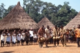 africa;african;africans;black;ethnic;male;people;person;persons;tradition;traditional;costume;costumes;traditions-costume;traditional-costumes;culture;cultural;cultures;tribe;tribes;tribal;west-africa;indigenous;native;stilts;dance;dancers;ceremony;ceremonies;sahel;zala;zaala;village;ivory-coast;west-africa;cote-divoire;drum;drums;drummer;drummers;drumming;bongo;play;music;beat;rythym;village;mud;hut;thatched;roof;singers;women;singer;performance;huts;villages