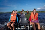 Africa;African;boat;boats;Botswana;boy;boys;child;children;delta;deltas;Endorheic-basin;girl;girls;Guma-Lagoon;inland-delta;internal-drainage-systems;Okavango;Okavango-Delta;Okavango-Swamp;people;person;river-delta;Seven-Natural-Wonders-of-Africa;Southern-Africa;tourism;tourist;tourist-boat;tourist-boats;tourists