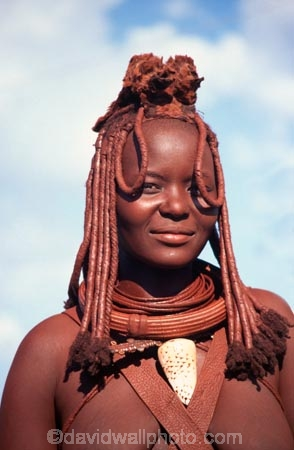 Himba-Woman;Himba;Namibia;Africa;Southern-Africa;tradition;traditional;traditions;culture;cultures;cultural;indigenous;native;jewelery;jewellery;adorn;adornment;adornments;costume;costumes;braid;braids;dreadlock;dreadlocks;braiding;necklace;necklaces;ochre;shell