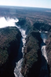 Victoria-Falls;Zambezi-River;Zimbabwe;Zambia;Africa;African;Southern-Africa;aerial;waterfall;waterfalls;water;nature;natural;wonder-of-the-world;world-wonder;seven-natural-wonders-of-the-wo;mist;misty;spary;refraction;high;power;powerful;vertical;;flow;chasm;global-warming;gush;cliff;cliffs;bluff;bluffs;crevasse;crevasses;falling;falls;fall;phenomena;phenomenon;precipice;precipices;aerial;aerials
