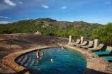 Africa;Big-Cave-Camp;Big-Cave-Lodge;camp;camps;lodge;lodges;Matobo-Hills;Matobo-National-Park;Matopos-Hills;people;person;pool;pools;resort;resorts;Southern-Africa;swim;swimmer;swimmers;swimming-pool;swimming-pools;Zimbabwe