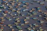 aerial;aerial-image;aerial-images;aerial-photo;aerial-photograph;aerial-photographs;aerial-photography;aerial-photos;aerial-view;aerial-views;aerials;Asia;Cambodia;Cambodian-floating-village;Cambodian-floodplain;Cambodian-village;Chong-Khneas;Chong-Khneas-Floating-Village;Chong-Khnies;Chong-Kneas;Chong-Kneas-Floating-Village;dirty-water;floating-home;floating-homes;floating-house;floating-houses;Floating-Village;Floating-Villages;freshwater-lake;freshwater-lakes;Indochina-Peninsula;Kampuchea;Kingdom-of-Cambodia;lake;lakes;Lower-Mekong-Basin;Mekong-Plain;muddy-water;Siem-Reap;Siem-Reap-Province;Southeast-Asia;Tonle-Sap;Tonle-Sap-Lake;Tonlé-Sap;Tonlé-Sap-Lake;UNESCO-Biosphere-Reserve;water