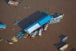 aerial;aerial-image;aerial-images;aerial-photo;aerial-photograph;aerial-photographs;aerial-photography;aerial-photos;aerial-view;aerial-views;aerials;Asia;boat;boats;Cambodia;Cambodian-floating-village;Cambodian-floodplain;Cambodian-village;canoe;canoes;Chong-Khneas;Chong-Khneas-Floating-Village;Chong-Khnies;Chong-Kneas;Chong-Kneas-Floating-Village;dirty-water;Floating-Village;Floating-Villages;freshwater-lake;freshwater-lakes;Indochina-Peninsula;Kampuchea;Kingdom-of-Cambodia;lake;lakes;long-boat;long-boats;Lower-Mekong-Basin;Mekong-Plain;muddy-water;Siem-Reap;Siem-Reap-Province;Southeast-Asia;Tonle-Sap;Tonle-Sap-Lake;Tonlé-Sap;Tonlé-Sap-Lake;UNESCO-Biosphere-Reserve;water