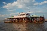 Asia;Cambodia;Cambodian-floating-village;Cambodian-floodplain;Cambodian-village;Chong-Khneas;Chong-Khneas-Floating-Village;Chong-Khnies;Chong-Kneas;Chong-Kneas-Floating-Village;floating-home;floating-homes;floating-house;floating-houses;floating-restaurant;floating-restaurants;floating-shop;floating-shops;Floating-Village;Floating-Villages;freshwater-lake;freshwater-lakes;Indochina-Peninsula;Kampuchea;Kingdom-of-Cambodia;lake;lakes;Lower-Mekong-Basin;Mekong-Plain;restaurant;restaurants;Siem-Reap;Siem-Reap-Province;Southeast-Asia;Tonle-Sap;Tonle-Sap-Lake;Tonlé-Sap;Tonlé-Sap-Lake;tourism;tourist-restaurant;tourist-restaurants;UNESCO-Biosphere-Reserve
