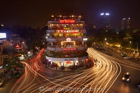 Bars restaurants and lights from traffic at busy intersection by asiabarbarscafecafescarcar lights aloadofball Image collections