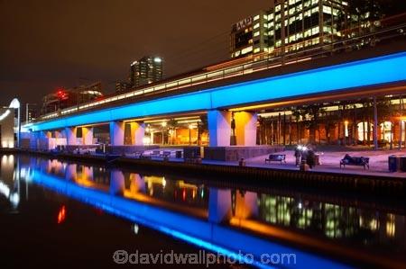 Buildings And Blue Lighting On Railway Bridge Reflected In